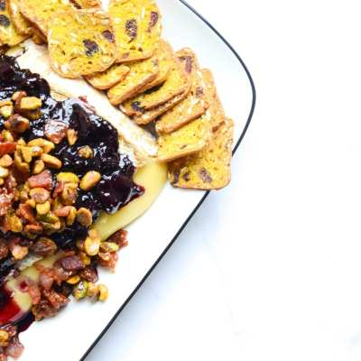 Baked Brie With Red Wine Cherries, Candied Bacon and Pistachios