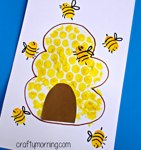 Bubble wrap art of Beehive and fingerprint yellow bees.