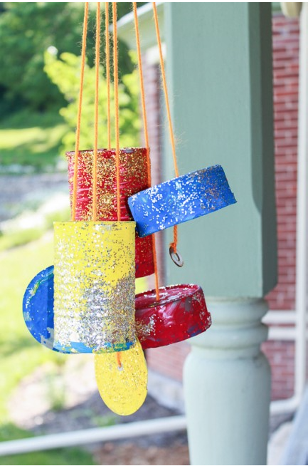 Recycled art projects of can wind chimes.
