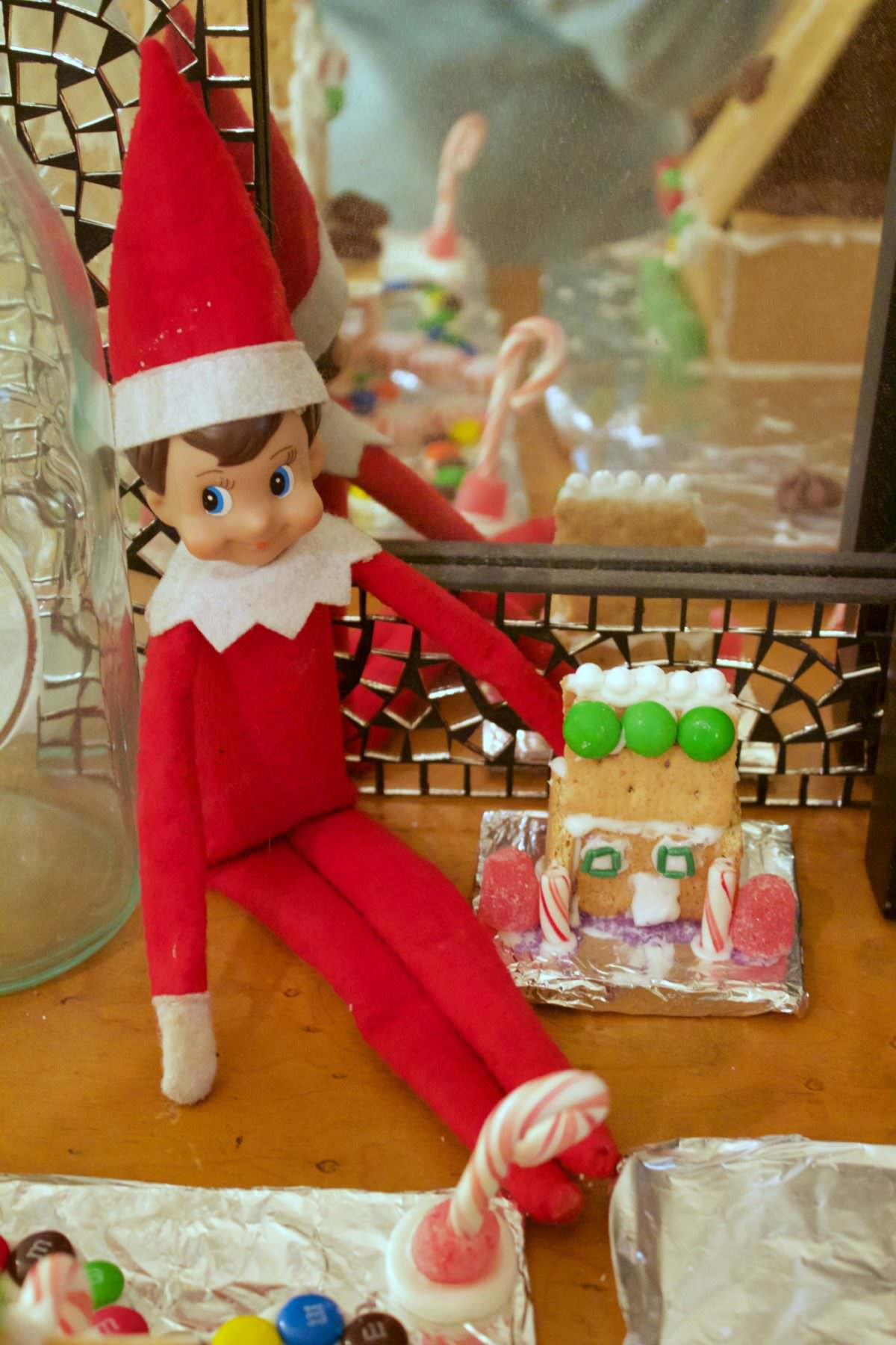 Elf on the shelf with a Gingerbread house