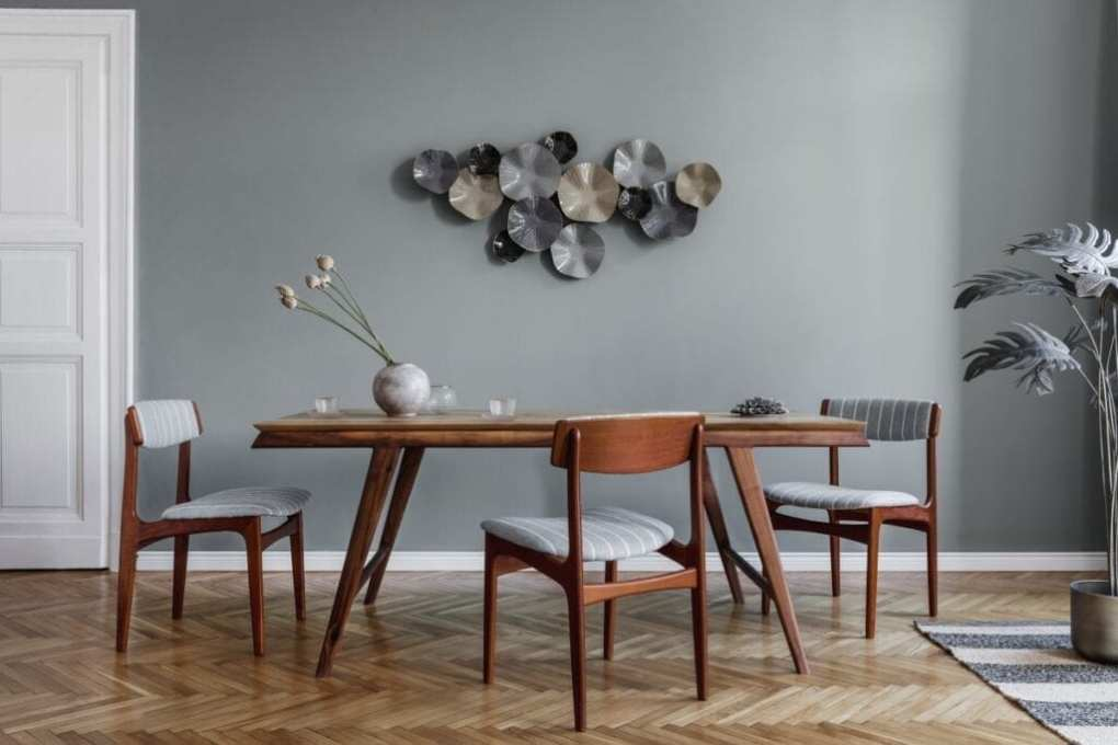 Dining room with modern sculpture wall art