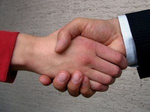 shake hands selling a property