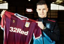 Frederick Gilbert holds up Aston Villa shirt