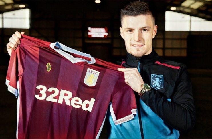 Frederick Gilbert holds up Aston Villa shirt