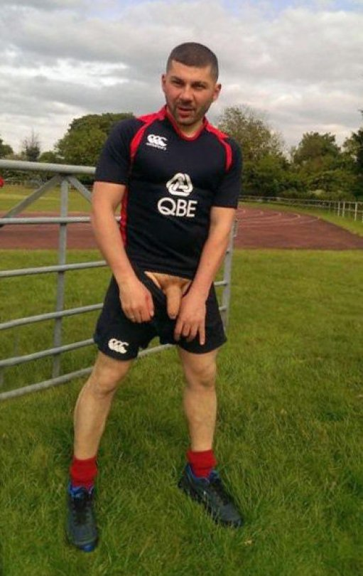 hung_uncut_rugby_player_cock_out_of_shorts_at_training_