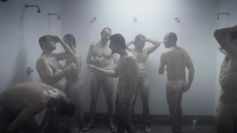 group-of-men-naked-in-showers