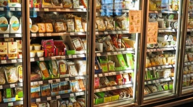 Creative Commons Photo of supermarket freezer aisle - this article covers frozen paleo meals available from national retailers like Whole Foods Market, Trader Joes and Walmart, as well as local health food stores. The Paleo frozen dinners offered by these companies can be reheated in the microwave, just like a traditional tv dinner from the supermarket, but with the advantage of using organic and grass fed, grass finished meat, wild seafood, wild fish and other high quality proteins. We also cover getting frozen paleo meals delivered from several of the companies covered, which offer frozen Paleo meals, but ship those meals directly to your door so that it's easy to stock up your freezer with Paleo meals, no matter if you live in a big city or remote town or village.