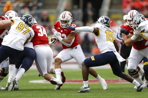 Taylor scores 5 TDs to lead No. 8 Wisconsin past Kent State ... on kent state football field, kent state women's soccer team, kent state ice arena, kent state art building, kent state indoor track, kent state baseball stadium, kent state football division,