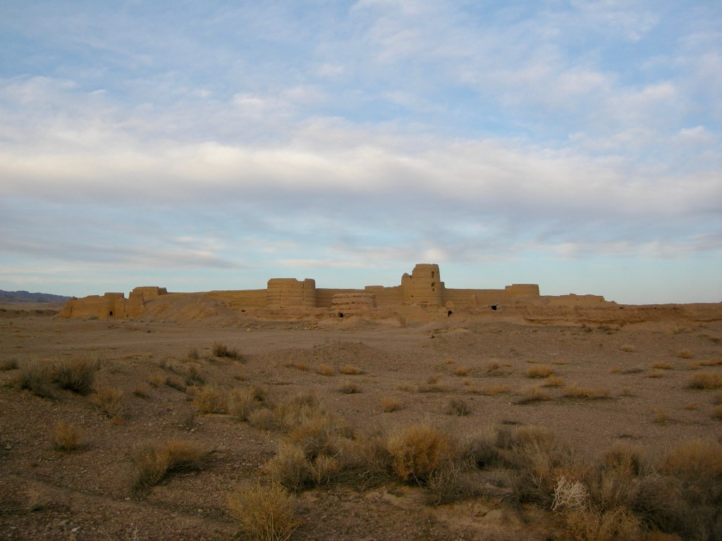 Camp under the desert stars next to an ancient adobe castle little-known by locals in Iran, the centuries-old Karshahi Fortress, once a den of thieves.