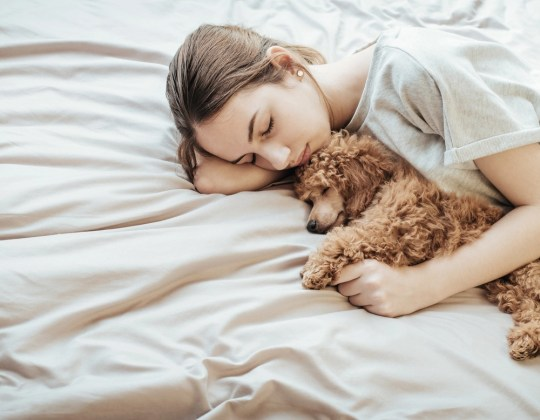 Should Our Pets Sleep With Us?