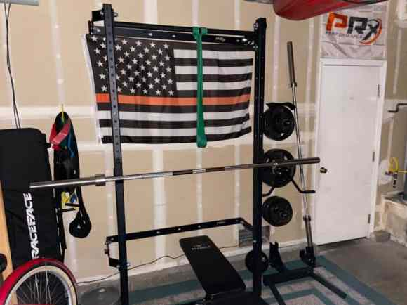 wall mounted squat rack garage gym setup