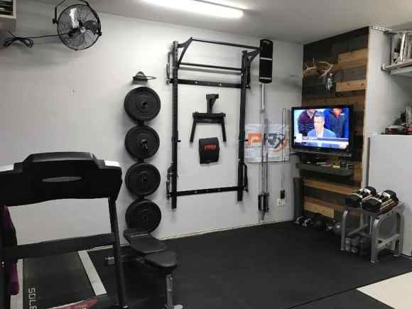 save space with wall mounted squat rack