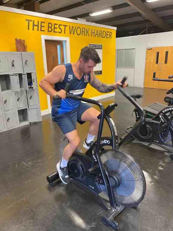 Fitness Freak on Air Bike Working Hard