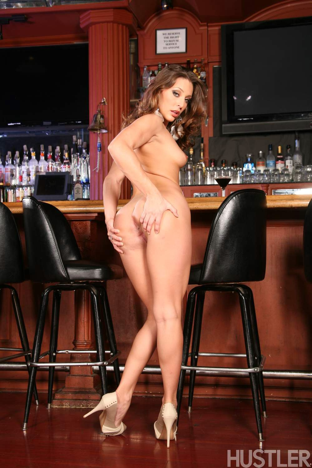 Gracie Glam in high heels posing at the bar  My Pornstar Book