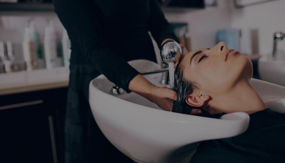 Woman having her hair shampooed in a salon