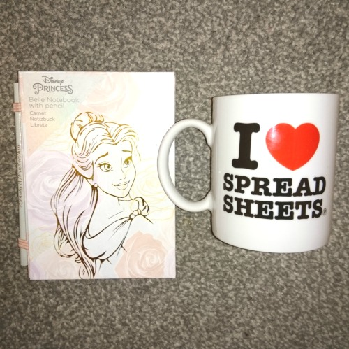 "#Giveaway prize featuring an ""I heart spreadsheets"" mug and a notepad and pencil featuring Disney Princess Belle"