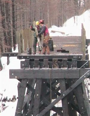 Placing Railing Posts on Trestle 3. Photo taken March 9, 2006.