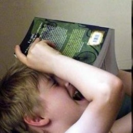 child reading a funny book