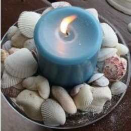 candle with seashells
