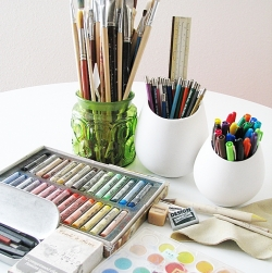 Pastels, brushes, and other art supplies