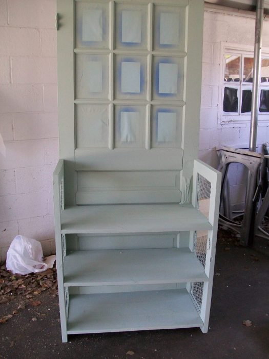 repurposed door bookshelf after painting