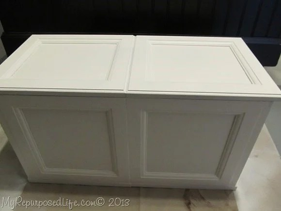 white toy box made from cabinet doors