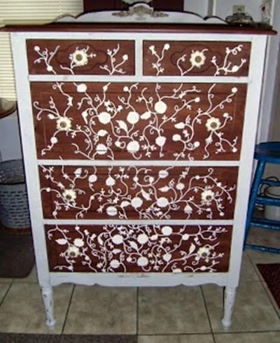 hand-painted vines on a dresser