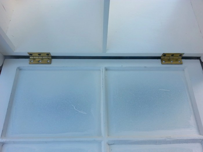 add hinges to window to make a cabinet door