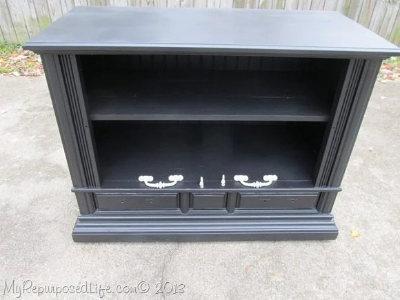black cabinet with white hardware