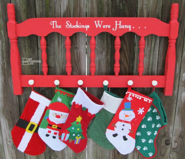 repurposed headboard stocking holder