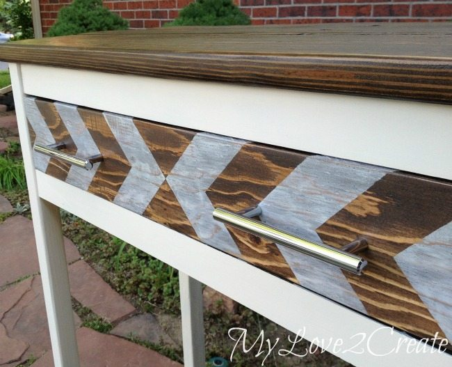Close up of entry table arrow painted drawer