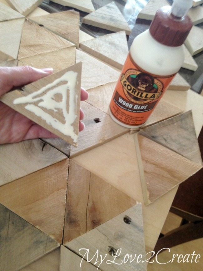 Gluing on pallet triangle pieces