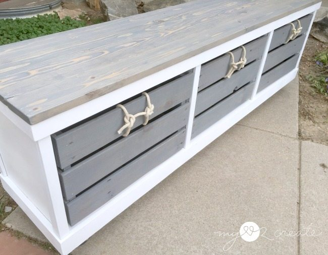 bench with crates and rope handles