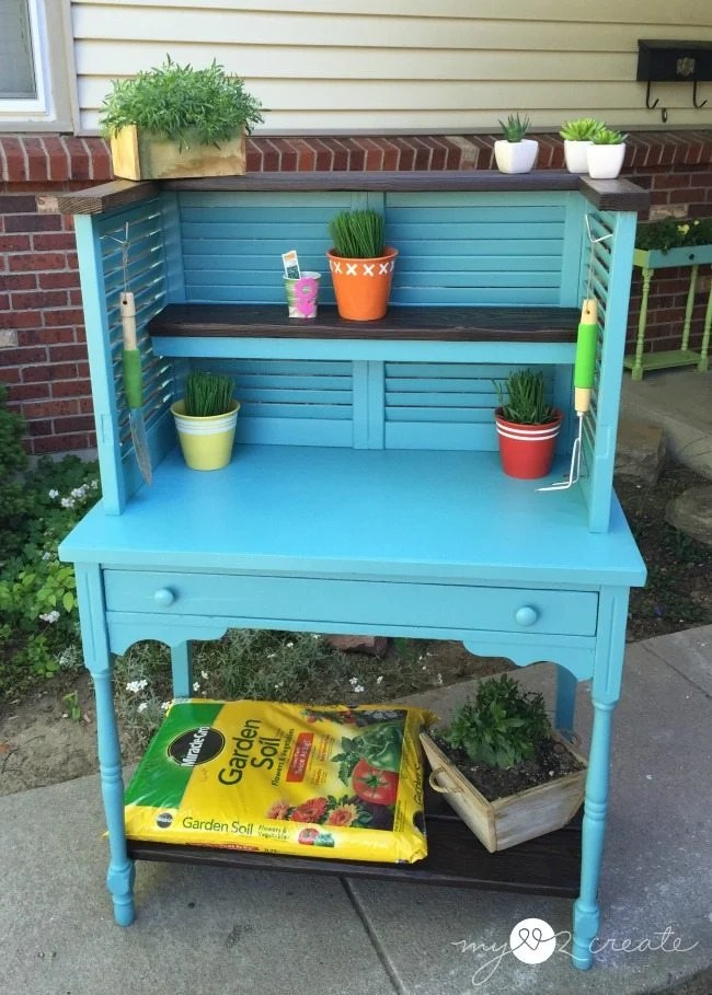 Repurposed shudders and desk into potting bench