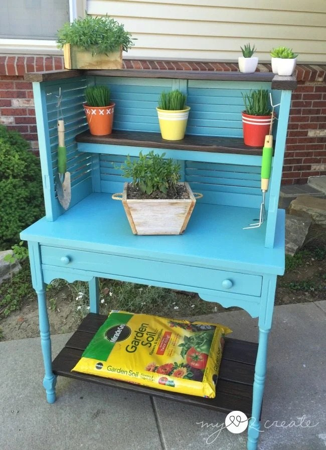 Repurposed Shutters and desk into potting bench. This potting bench could easily be used indoors for kitchen organization. #MyLove2Create #MyRepurposedLife #repurposed #shutters #desk #pottingbench via @repurposedlife