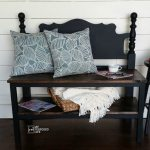 small black bench made from a headboard