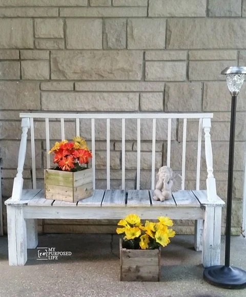 Using reclaimed spindles, crib rails and fence boards--it was easy to make this crib garden bench.  Awesome outdoor garden bench costing very little. Complete directions to make your own. #MyRepurposedLife #repurposed #furniture #outdoors #garden #bench via @repurposedlife