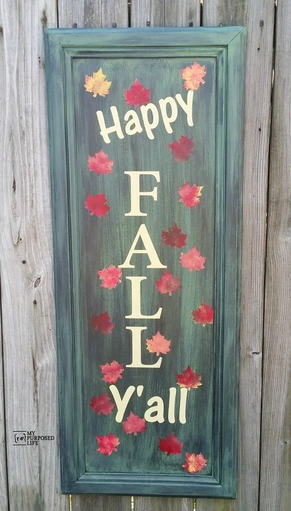 How to make an easy Happy Fall Yall sign out of a repurposed cabinet door. Paint and stenciling tips. Easy afternoon project for your fall porch or entryway. #MyRepurposedLife #repurposed #cabinet #door #sign #fall #decor #porch via @repurposedlife