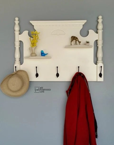 White Headboard Shelf Coat Rack. Add some shelves to an old headboard, hang it on the wall and add hooks! #MyRepurposedLife #repurposed #furniture #headboard #coatrack via @repurposedlife