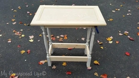 how to make a small table using a cabinet door and some spindles