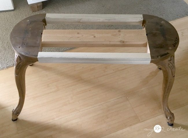 shot of bench support rails attaching bar stool legs together