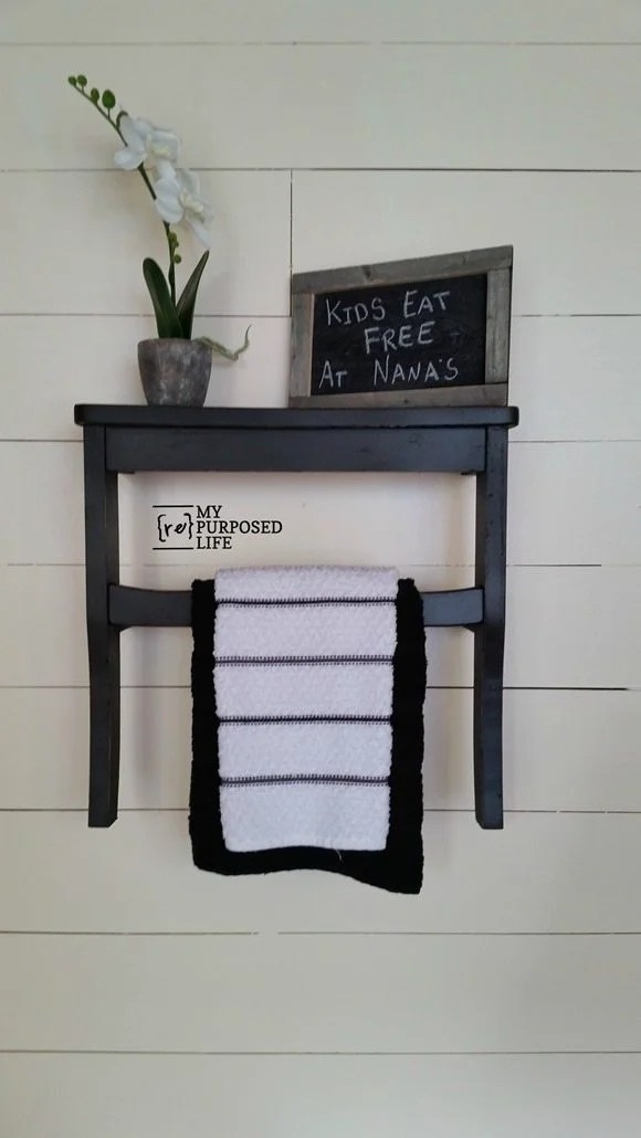 black kitchen towel rack shelf using repurposed chair seat MyRepurposedLife.com