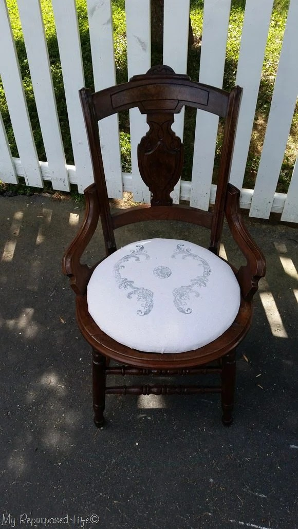 antique cane chair with a new upholstered seat