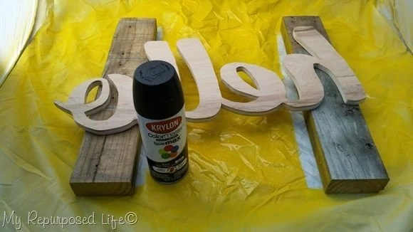 spray paint wooden cut out sign