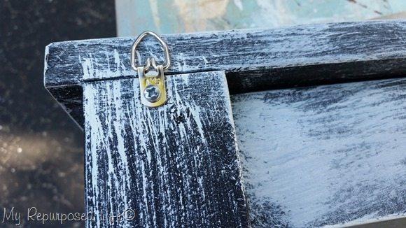 d rings on a distressed chalkboard coat rack