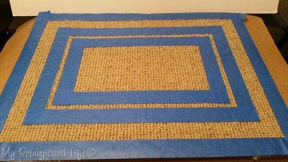 thin border painted rug