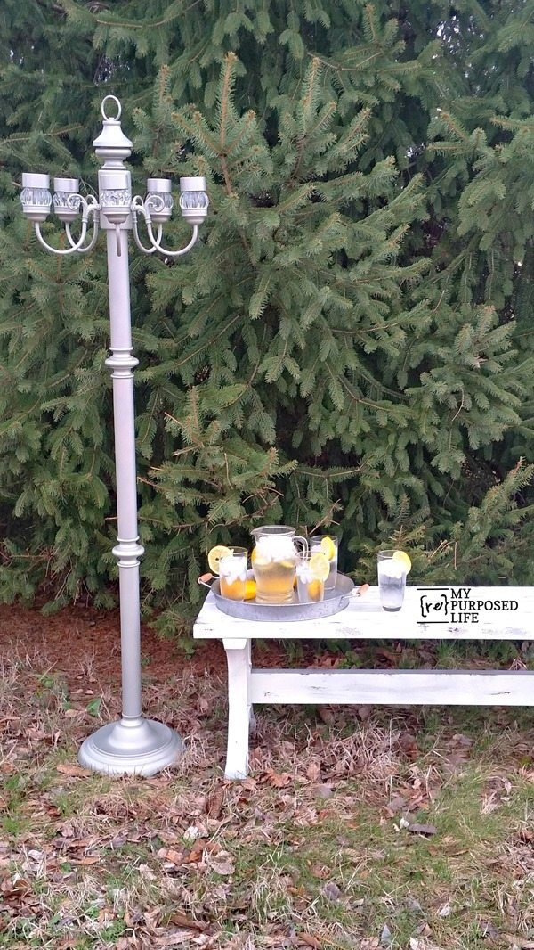 Repurposed floor lamp and a chandelier make a great garden or patio solar light feature. MyRepurposedLife.com