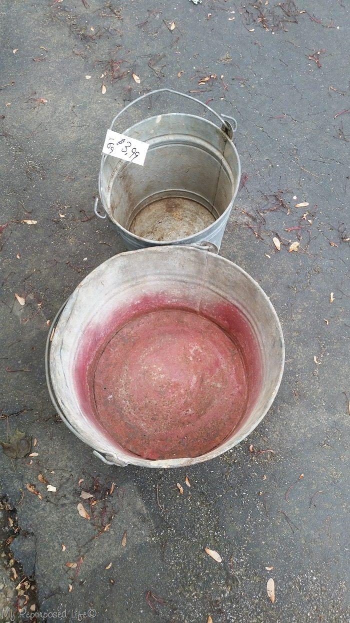 beat up galvanized buckets