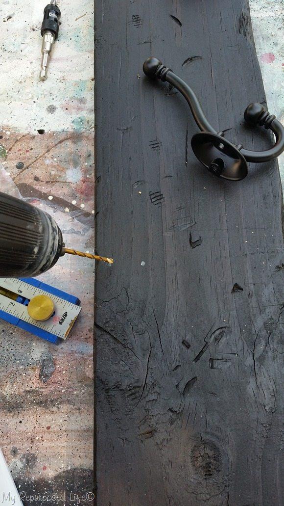 dark stained vertical coat rack board