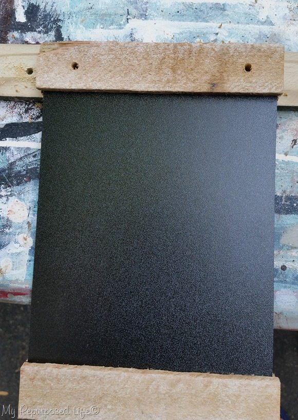 drill holes for hanging dollar store chalkboard